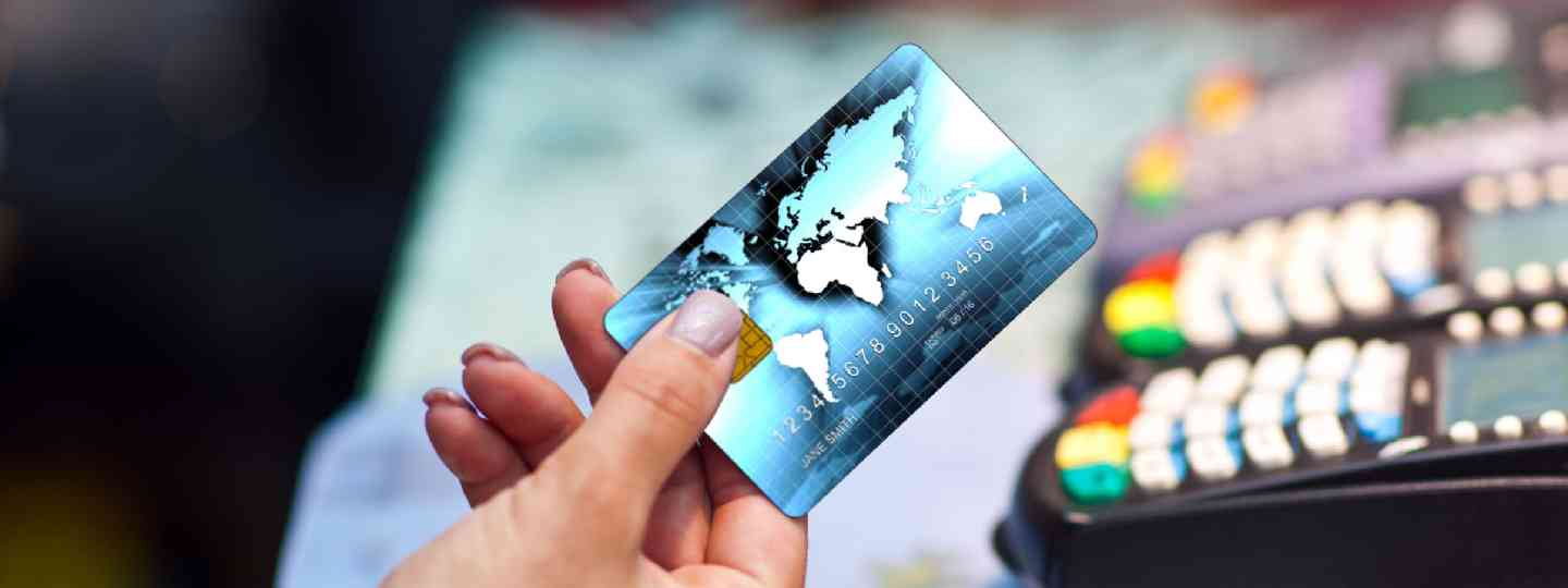 Woman holding a credit card (Shutterstock: see credit below)
