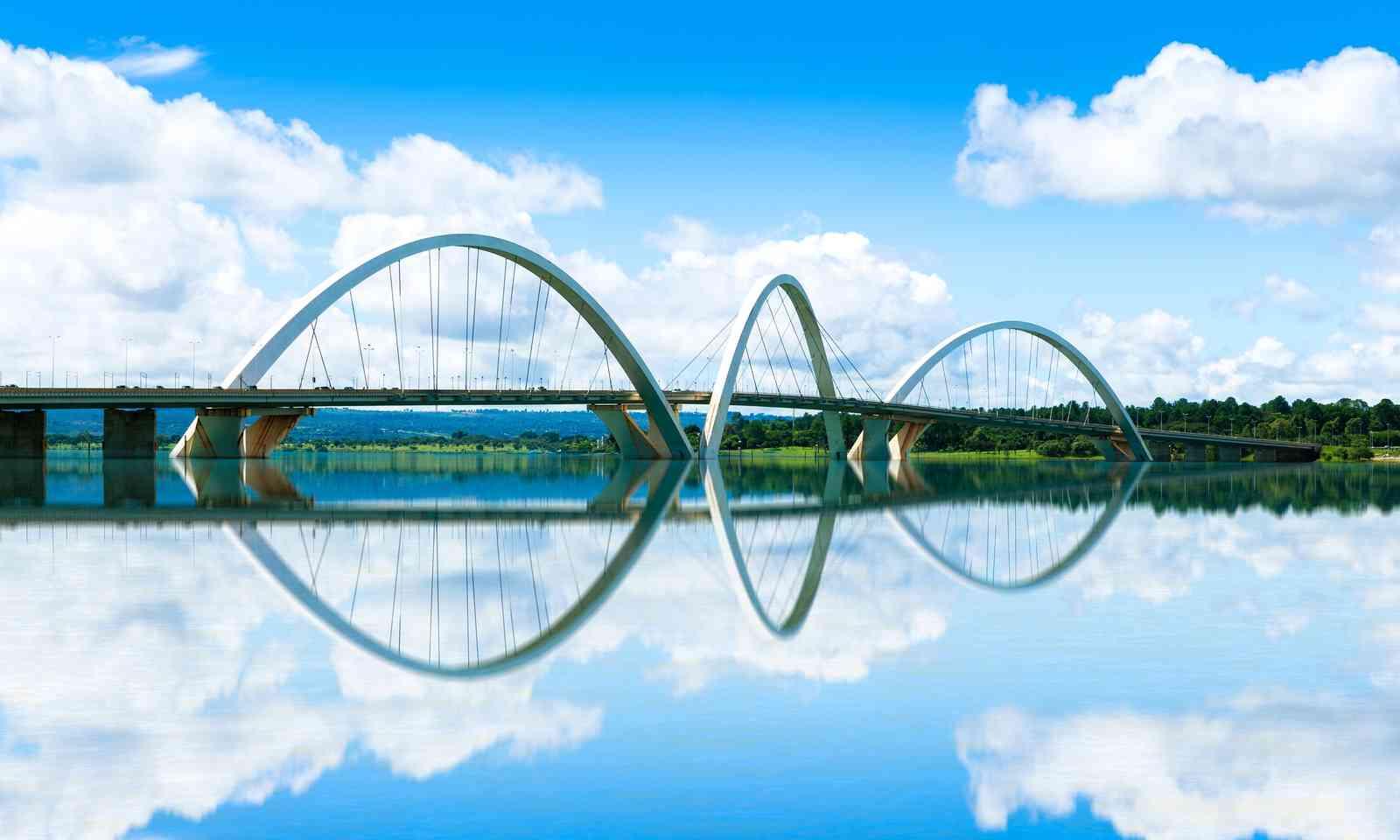The JK Bridge reflected in Lake Paranoá (Dreamstime)