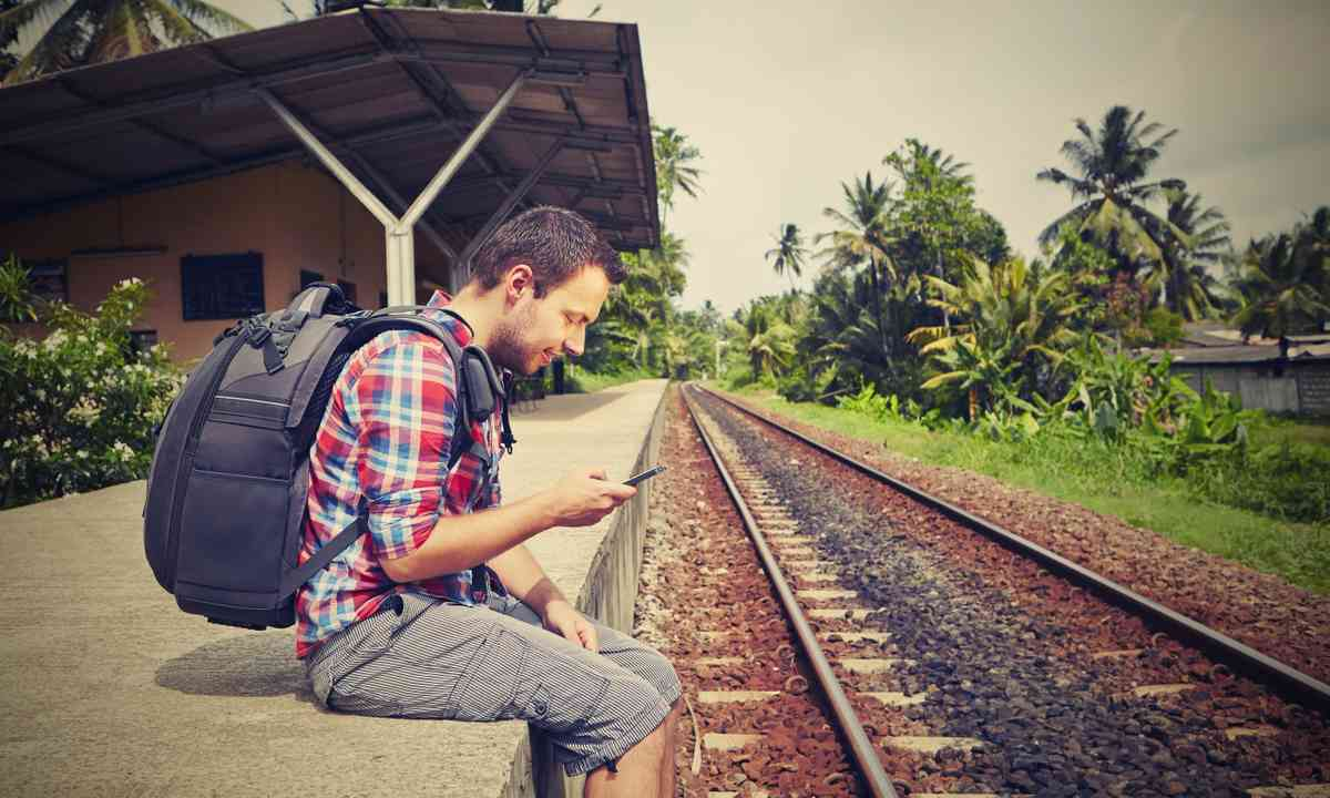 Traveller waiting for train in South East Asia (Shutterstock.com)