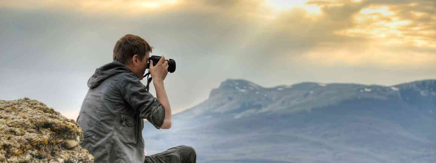 Boy photographing nature (Shutterstock.com. See main credit below)
