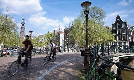 Cycling in Amsterdam (Dreamstime)