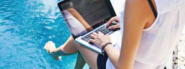Working poolside on a laptop (Shutterstock: see credit below)