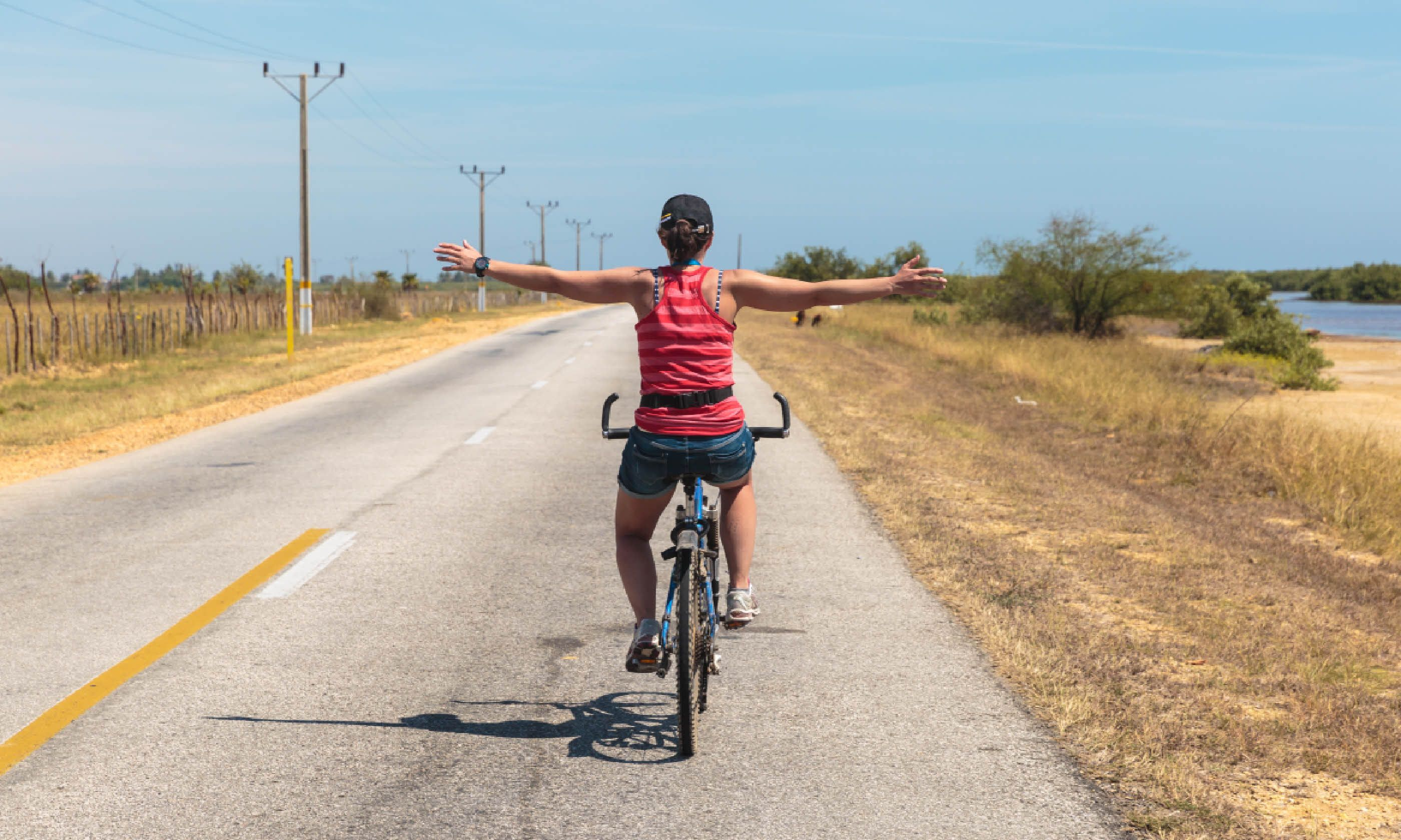 Relaxing cycling on the road of Trinidad, Cuba (Shutterstock)