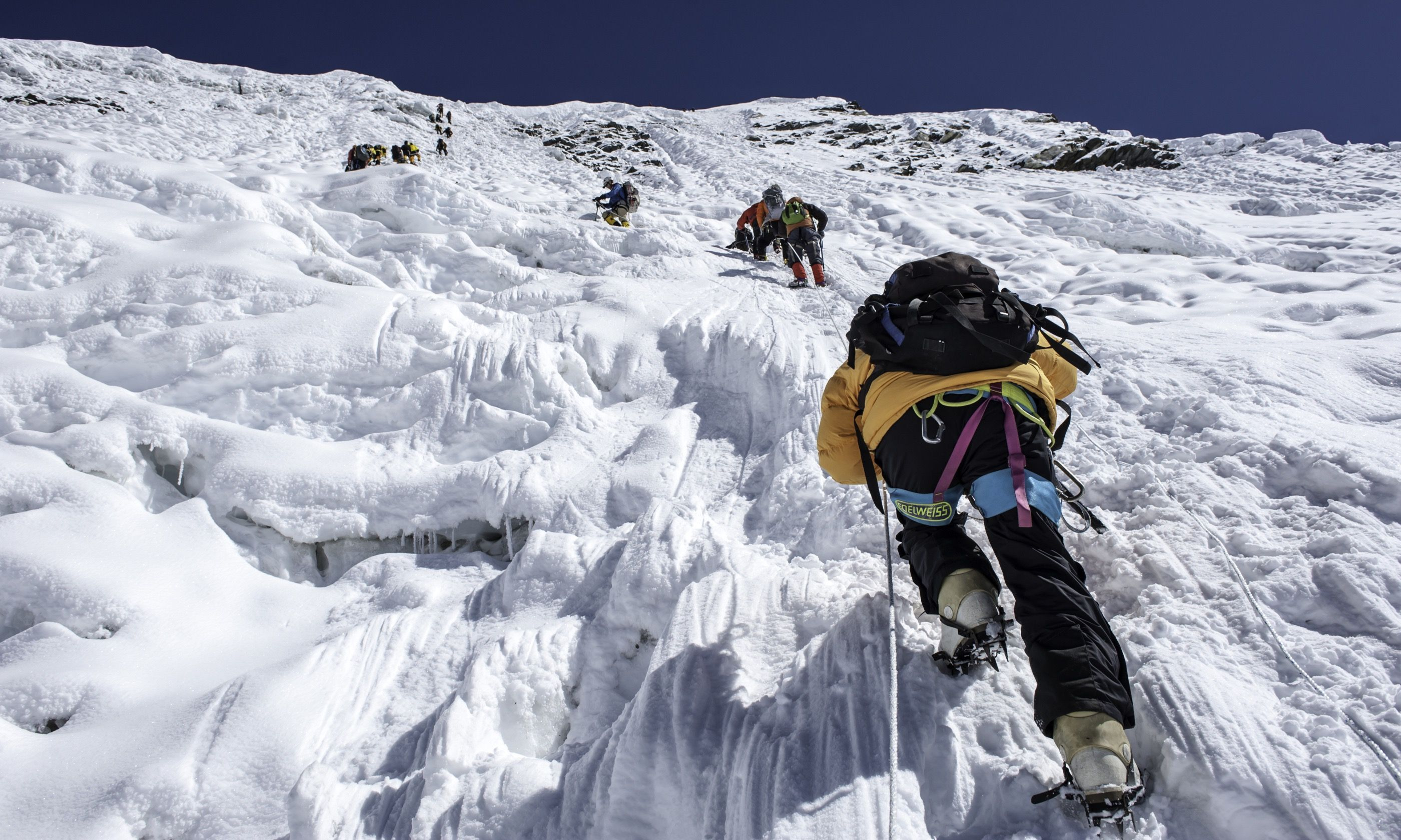 Climbing with ice pics (Shutterstock.com)