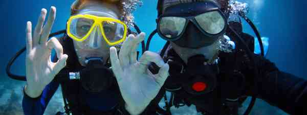 Young couple discover the joys of diving (Shutterstock: see main credit below)