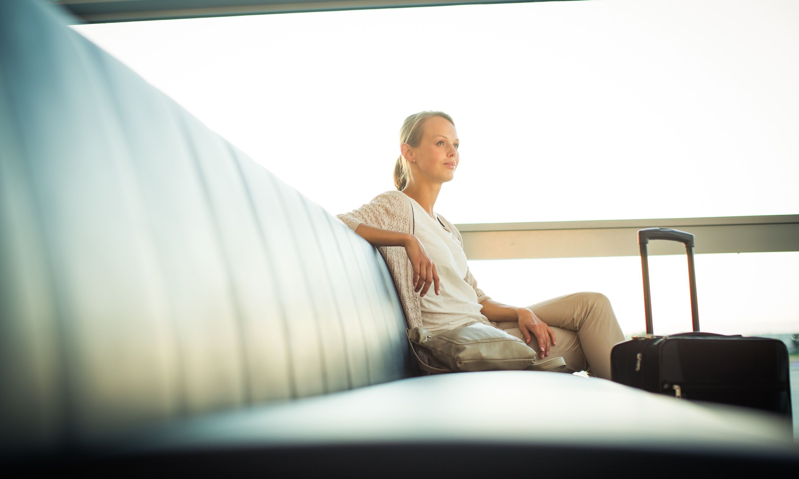 Woman waiting for flight (Shutterstockc.com)