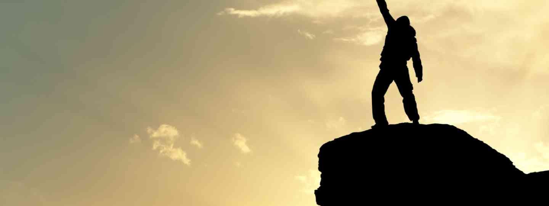 Man on top of mountain (Shutterstock)