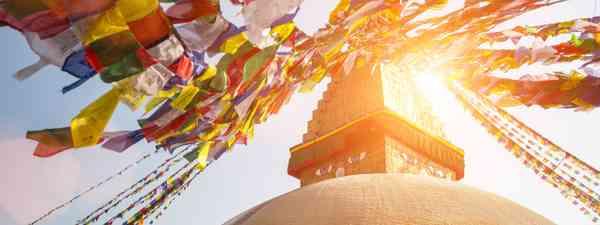 Bodnath Stupa sunshine (Shutterstock.com. See credit below)