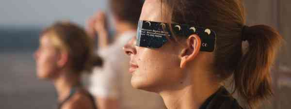 Traveller watching solar eclipse (Dreamstime)