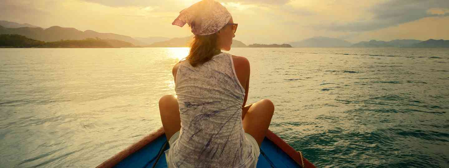 Woman enjoying sunset on boat (Shutterstock.com. See main credit below)