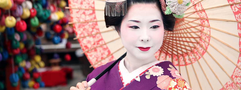 Geisha with umbrella in Kyoto, Japan (Dreamstime)