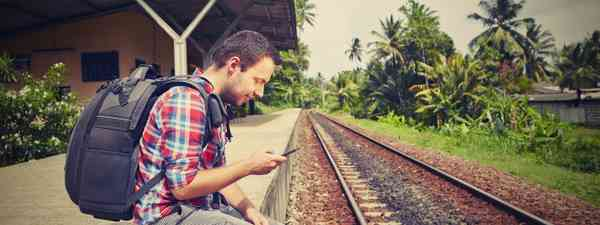 Backpacker waiting for a train in South East Asia (Shutterstock.com. See main credit below)
