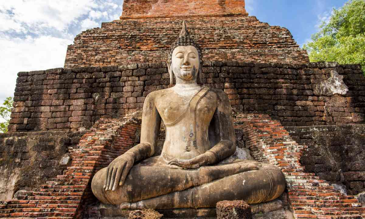 Ancient Buddha Statue at Sukhothai historical park (Dreamstime)