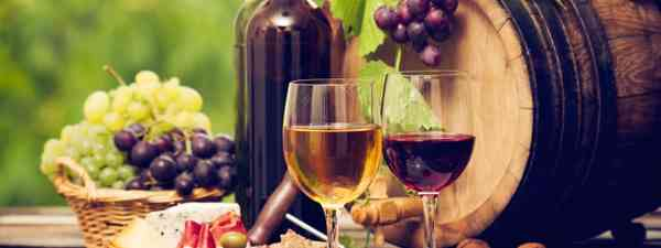 Wine, grapes, cheese and ham (Dreamstime)