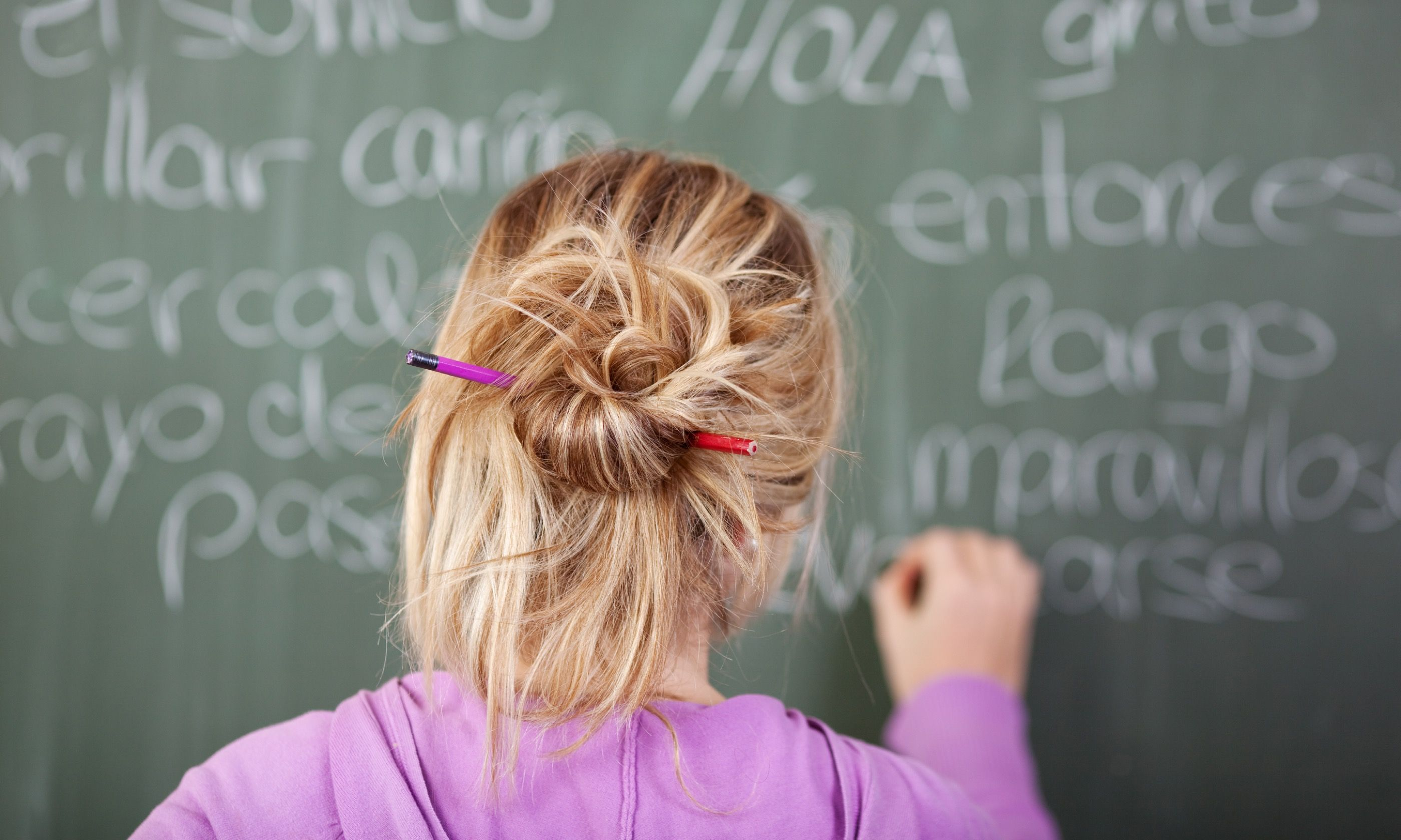 Female student during Spanish class (Shutterstock)