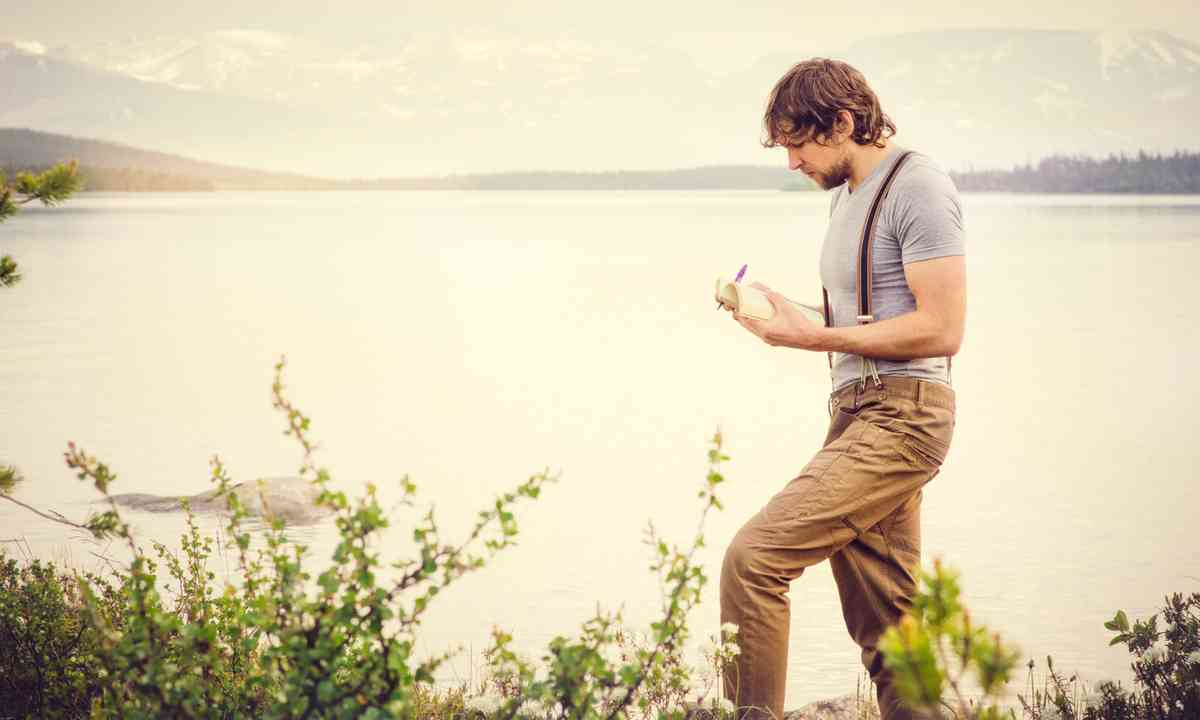 Guy taking notes in the wild (Shutterstock.com)