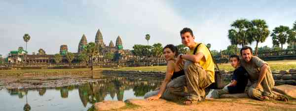 A family watching sunset at Angkor Was (Dreamstime)