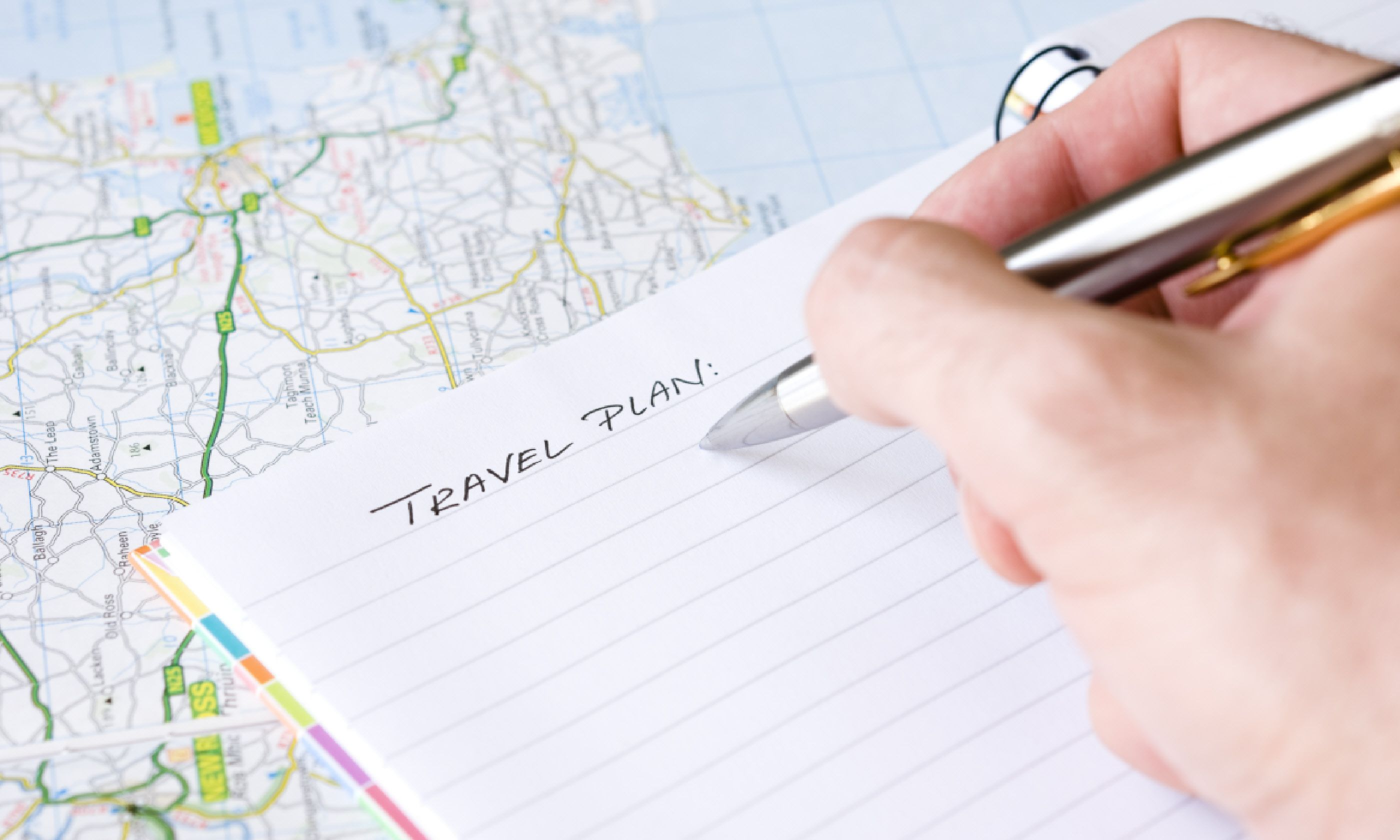 Writing travel plans (Shutterstock)
