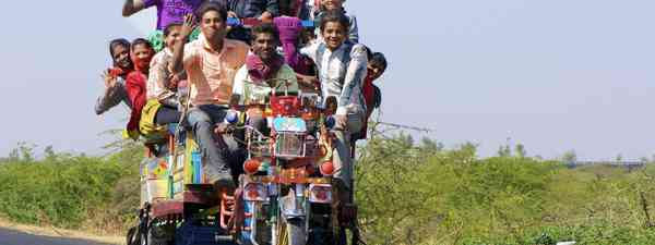 Overcrowded vehicle in India (Shutterstock.com. See main credit below)
