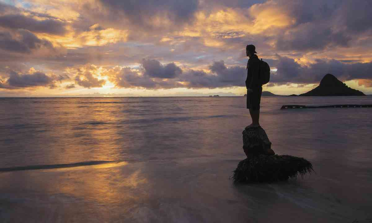 Solo traveller at sunset (Shutterstock.com)