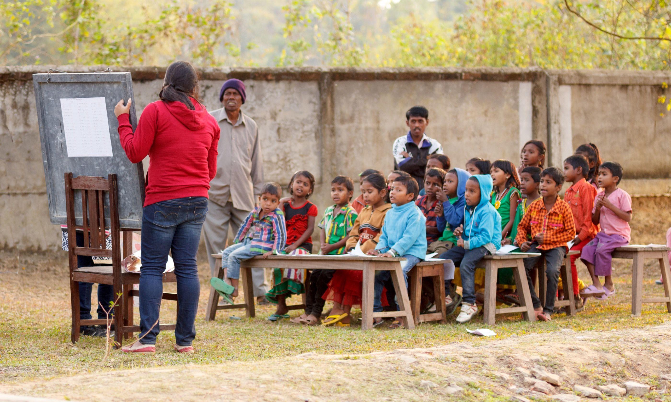 Teaching kids in India (Dreamstime)