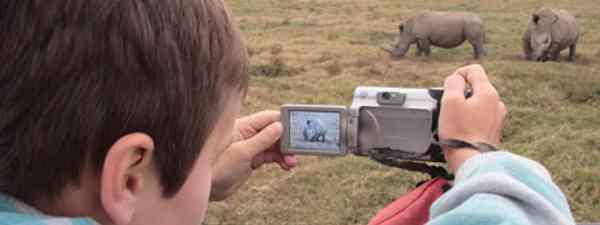 Joe snapping white rhino in Oserian Wildlife Sanctuary (William Gray)