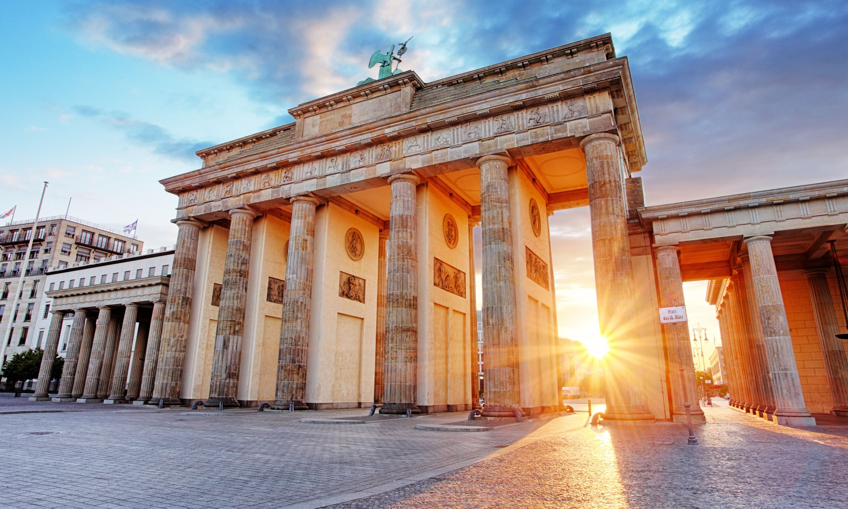 Sun shining through Brandenberg Gate (Shutterstock.com)