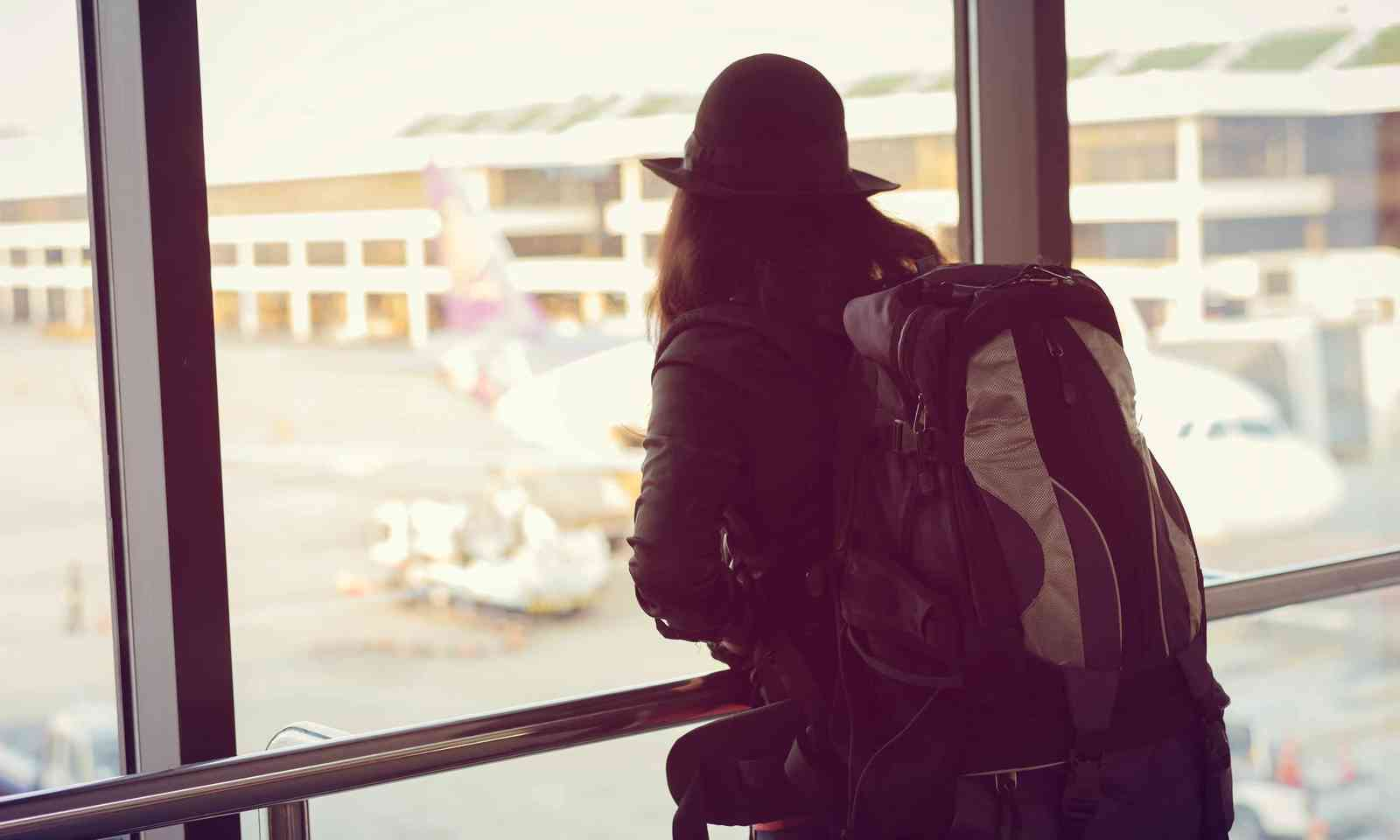 Woman waiting at airport (Shutterstock)