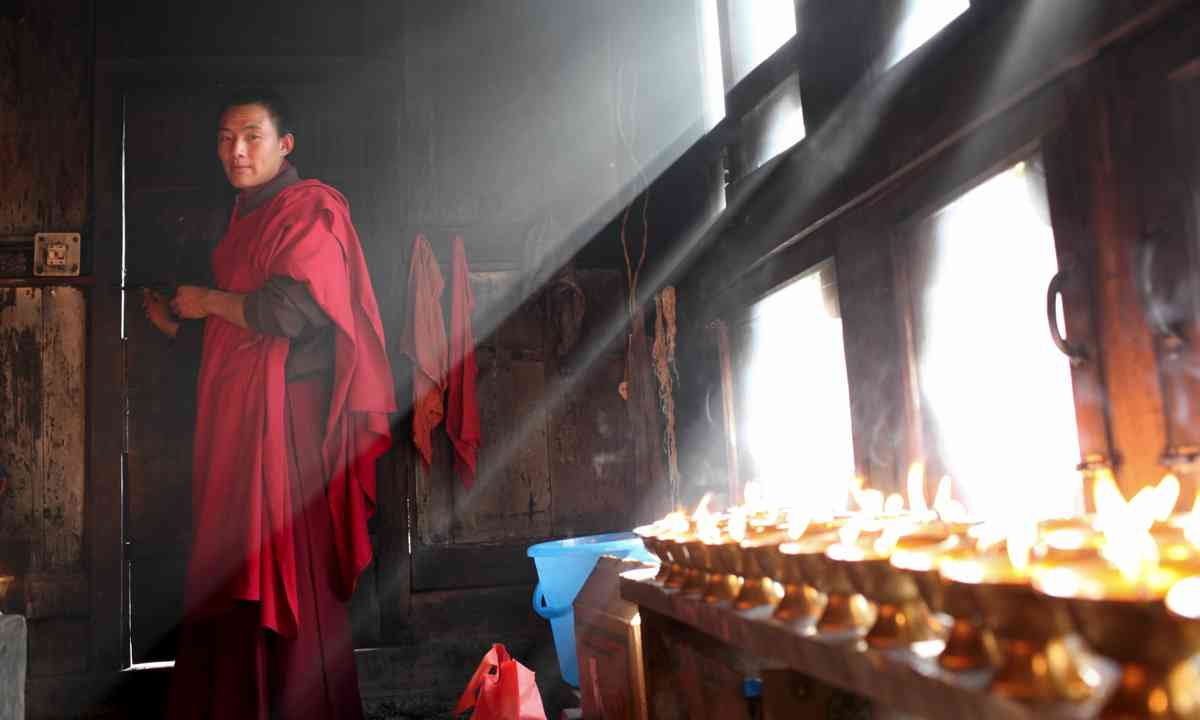 A monk in Bhutan (Dreamstime)