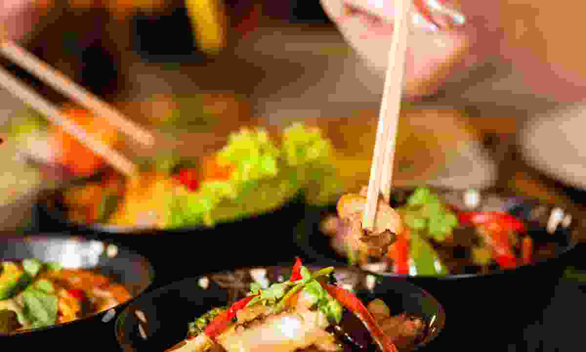 Eating Thai food (Dreamstime)