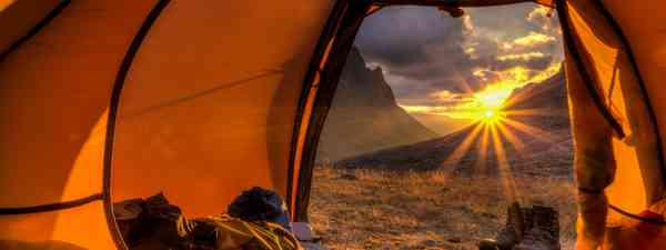 Sunrise in tent (Shutterstock.com. See main credit below)