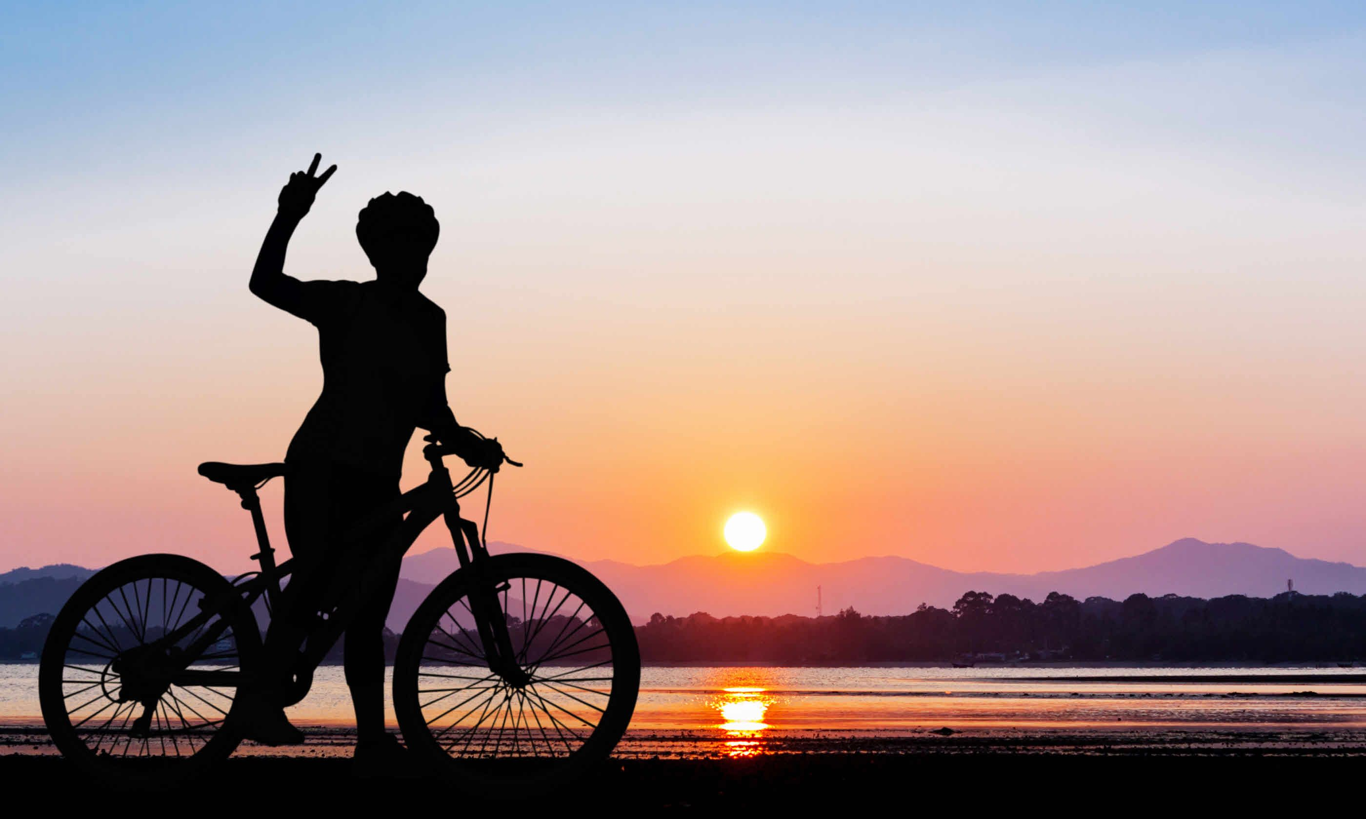 Cycling at sunset, Thailand (Shutterstock)