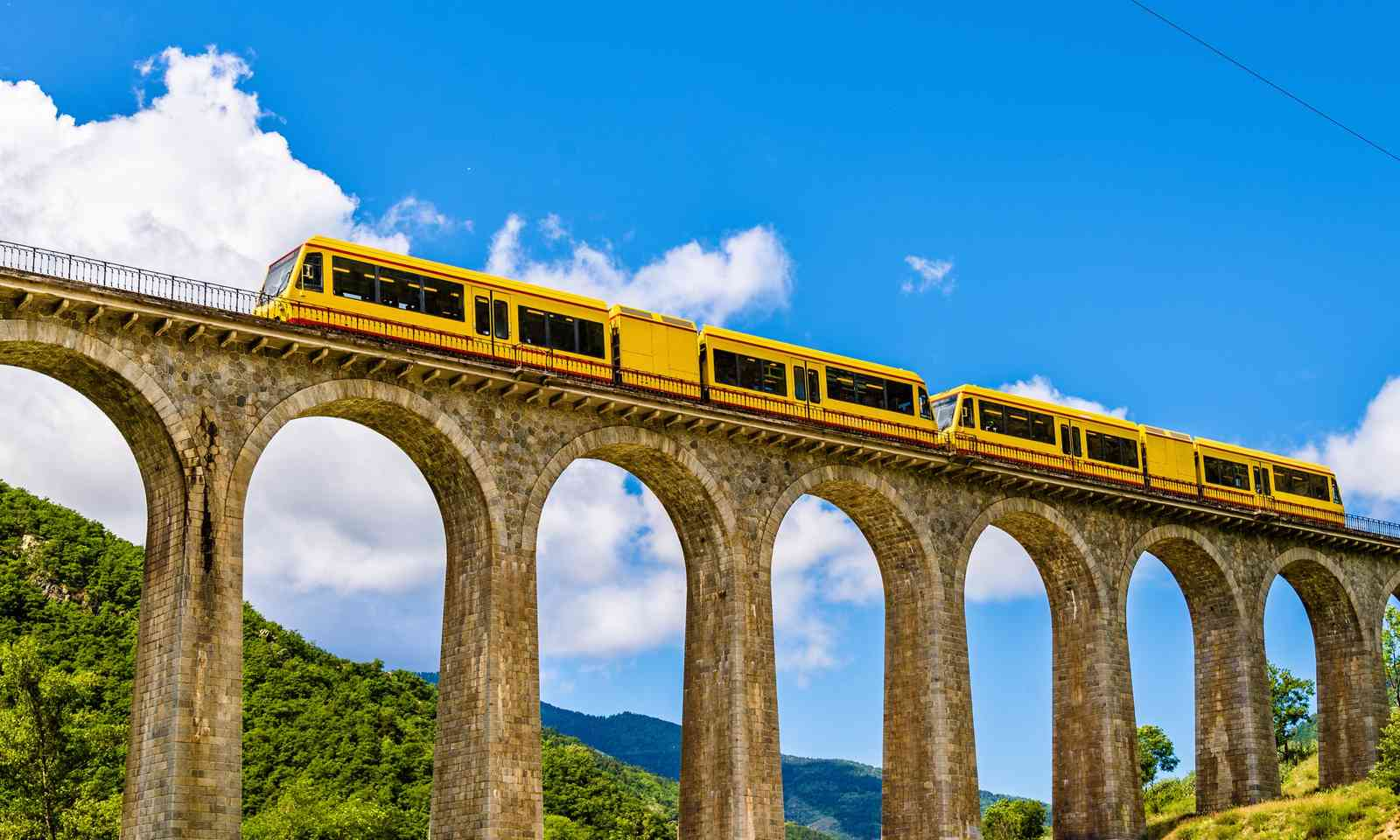 The Yellow Train on Sejourne Bridge (Dreamstime)