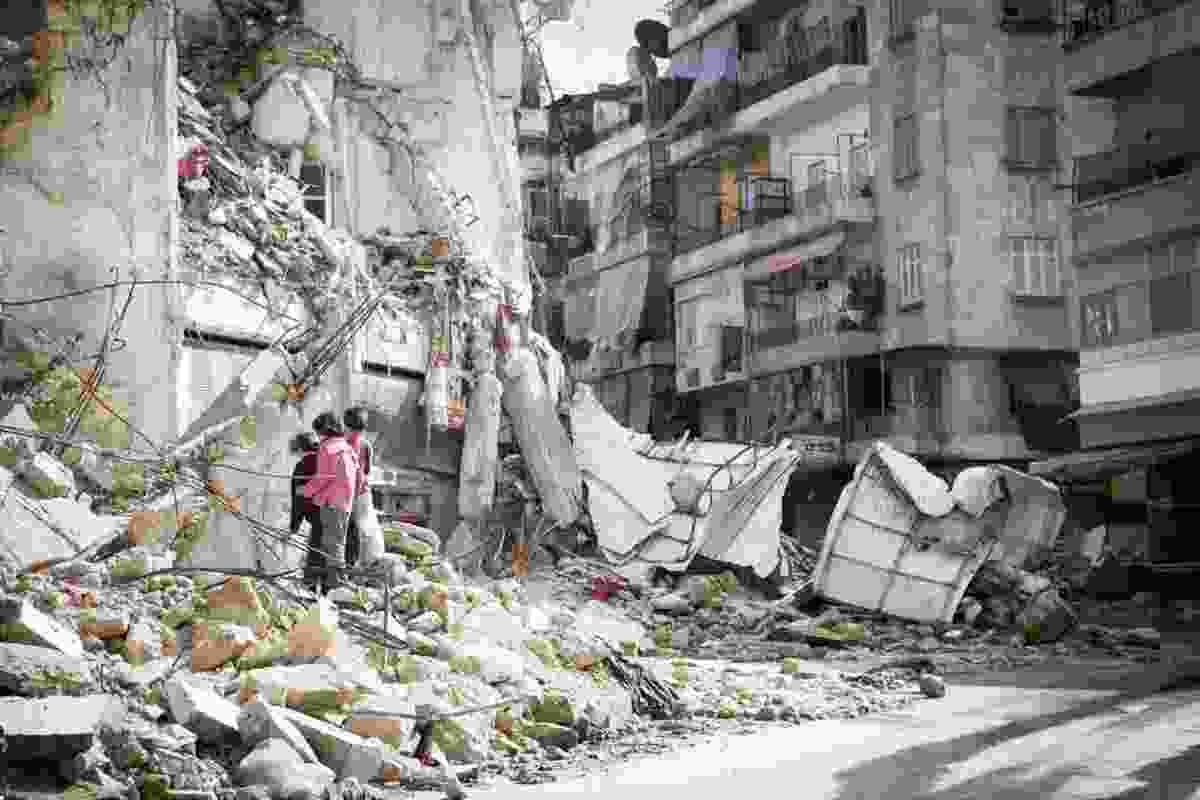 Children in rubble in Aleppo, Syria (Dreamstime)