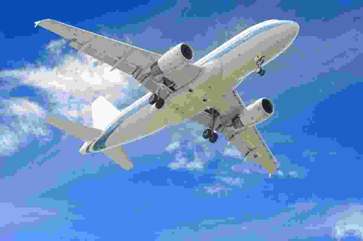 Aeroplane in blue skies (Dreamstime)