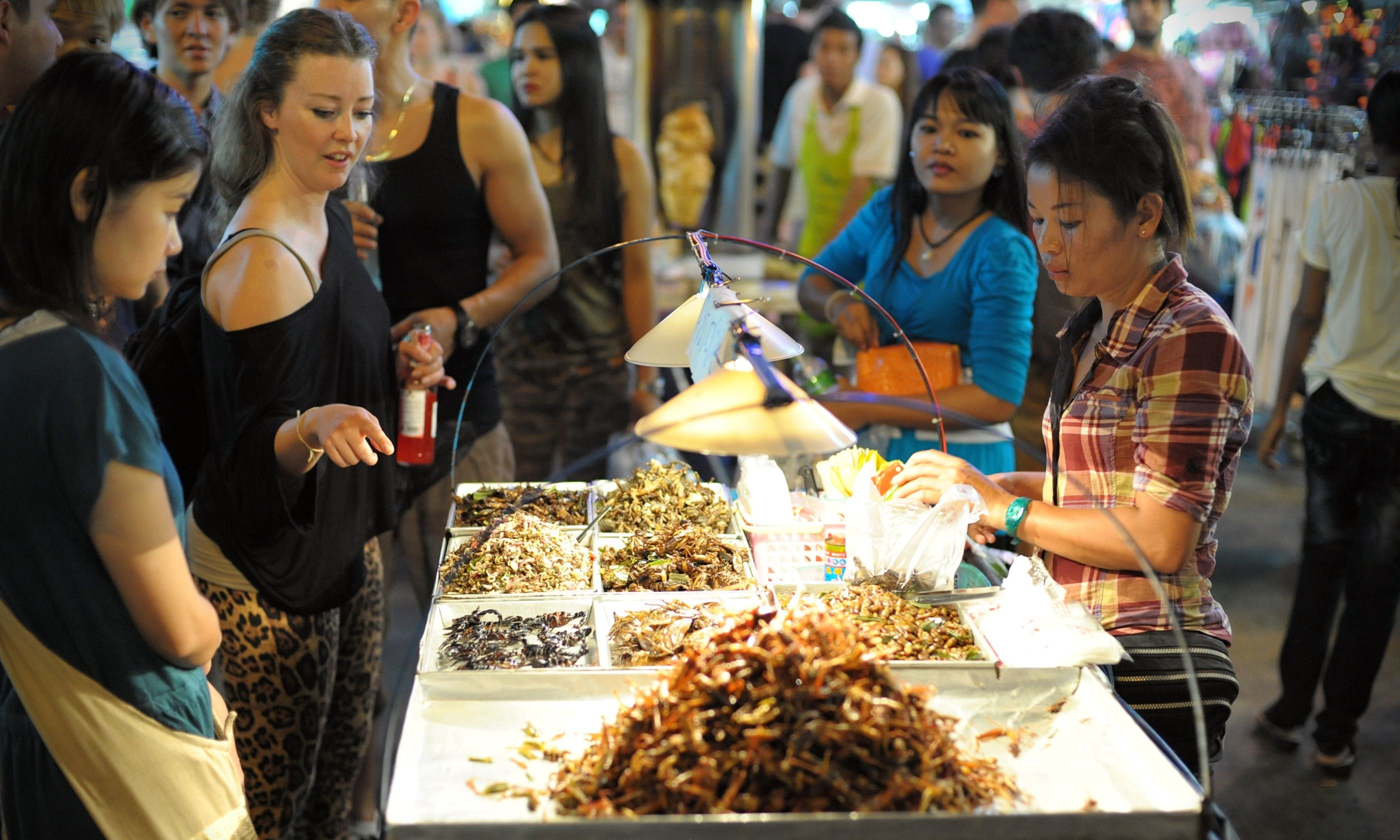 Trying new things in Thailand (Dreamstime)
