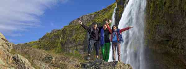 Family near waterfall in Iceland (Shutterstock.com. See main credit below)
