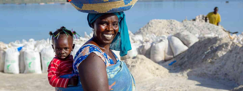 Smiling hawker at Lake Rebta (Shutterstock.com. See main credit below)