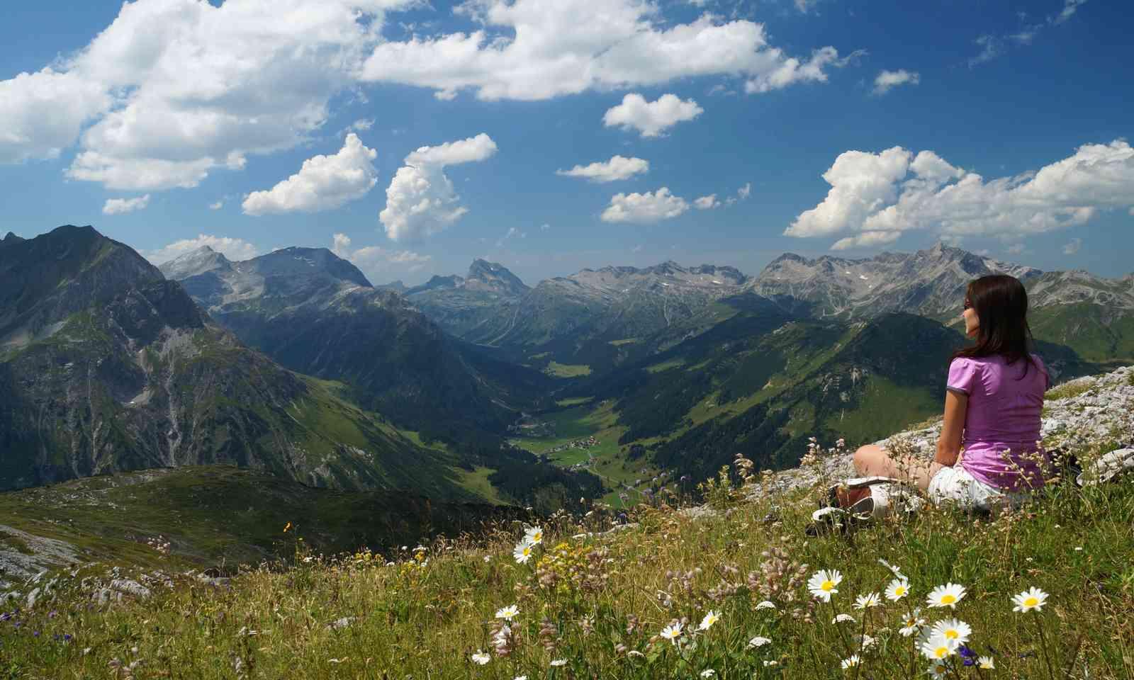 Woman resting in an Alpine meadow (Dreamstime)