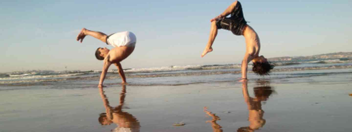 Martial arts dancers on the beach in Capoeira (freeflyer09)