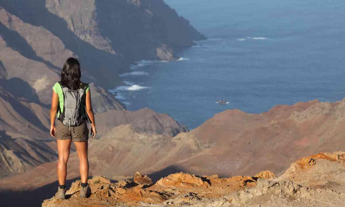 Hiker on volcanic basin in St Helena (Dreamstime)