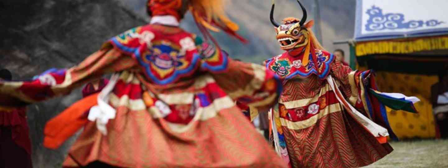Masked dancers in Bhutan (Shutterstock. See main credit below)