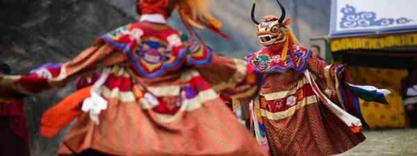 Masked dancers in Bhutan (Shutterstock. See main credit below)