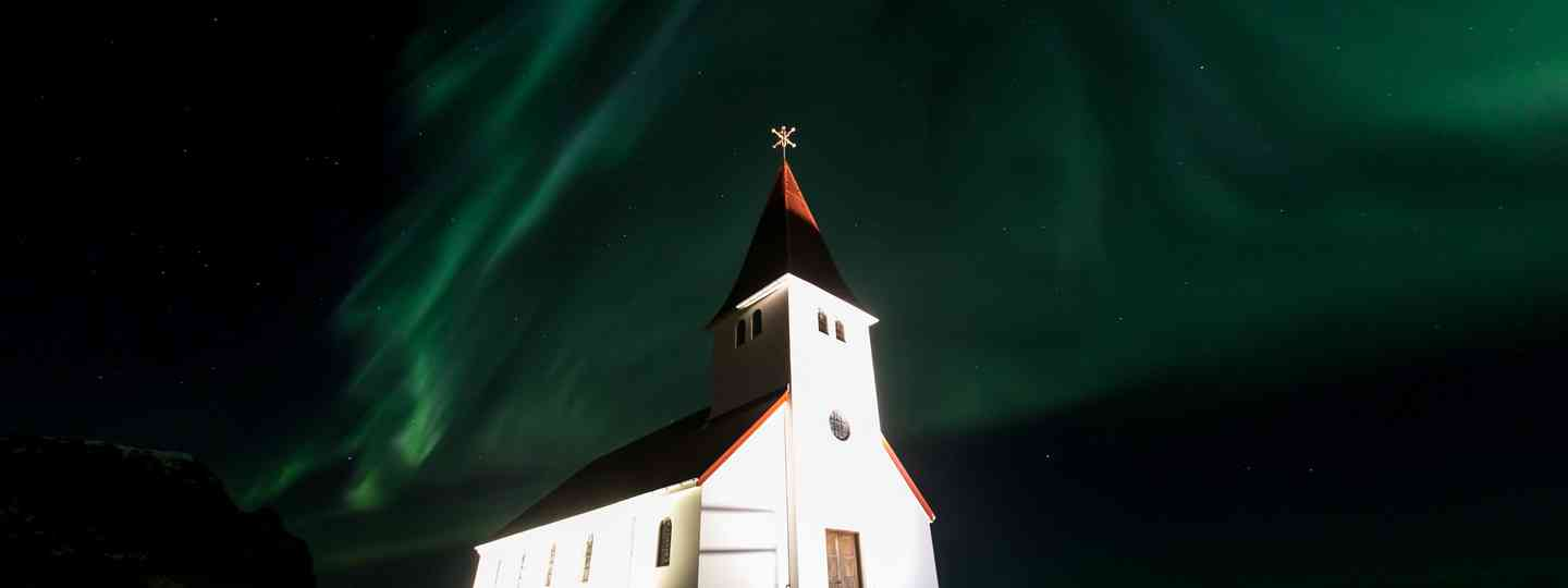 Vik Church, Iceland, under the Northern Lights (Dreamstime)