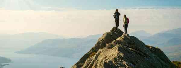 Hikers at Loch Katrine, Highlands, Scotland (Shutterstock: see credit below)