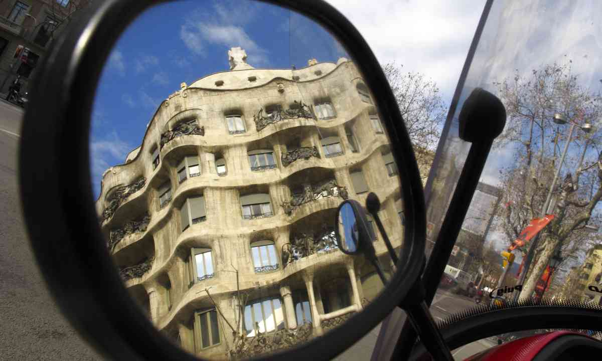 Gaudi in the wing mirror (Dreamstime)
