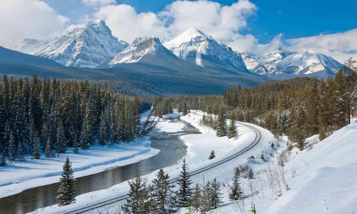 Train tracks in winter, Canadian Rockies (Dreamstime)
