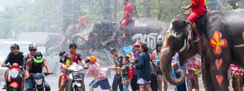 Revellers and elephants join in water splashing during Songkran Festival (Shutterstock)