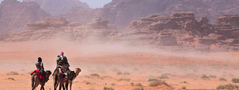 Camel riders in Jordan (Nickolay Vinokurov; Shutterstock)