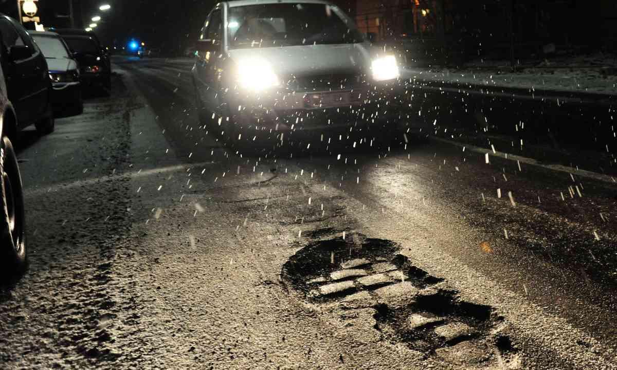 Potholed road. Possibly in Blackburn (Dreamstime)